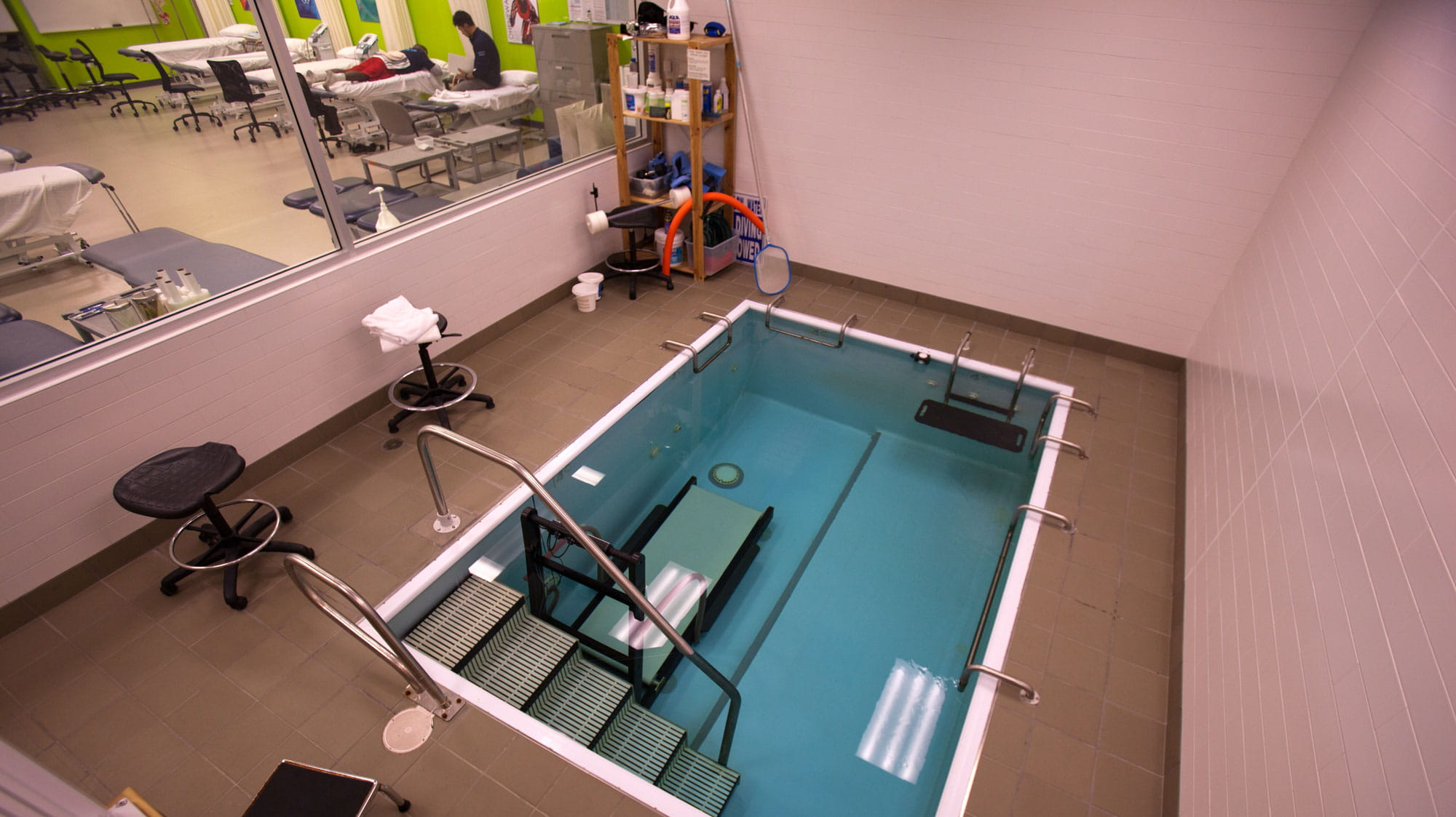 A small pool with an underwater treadmill in Sheridan's Athletic Therapy Clinic