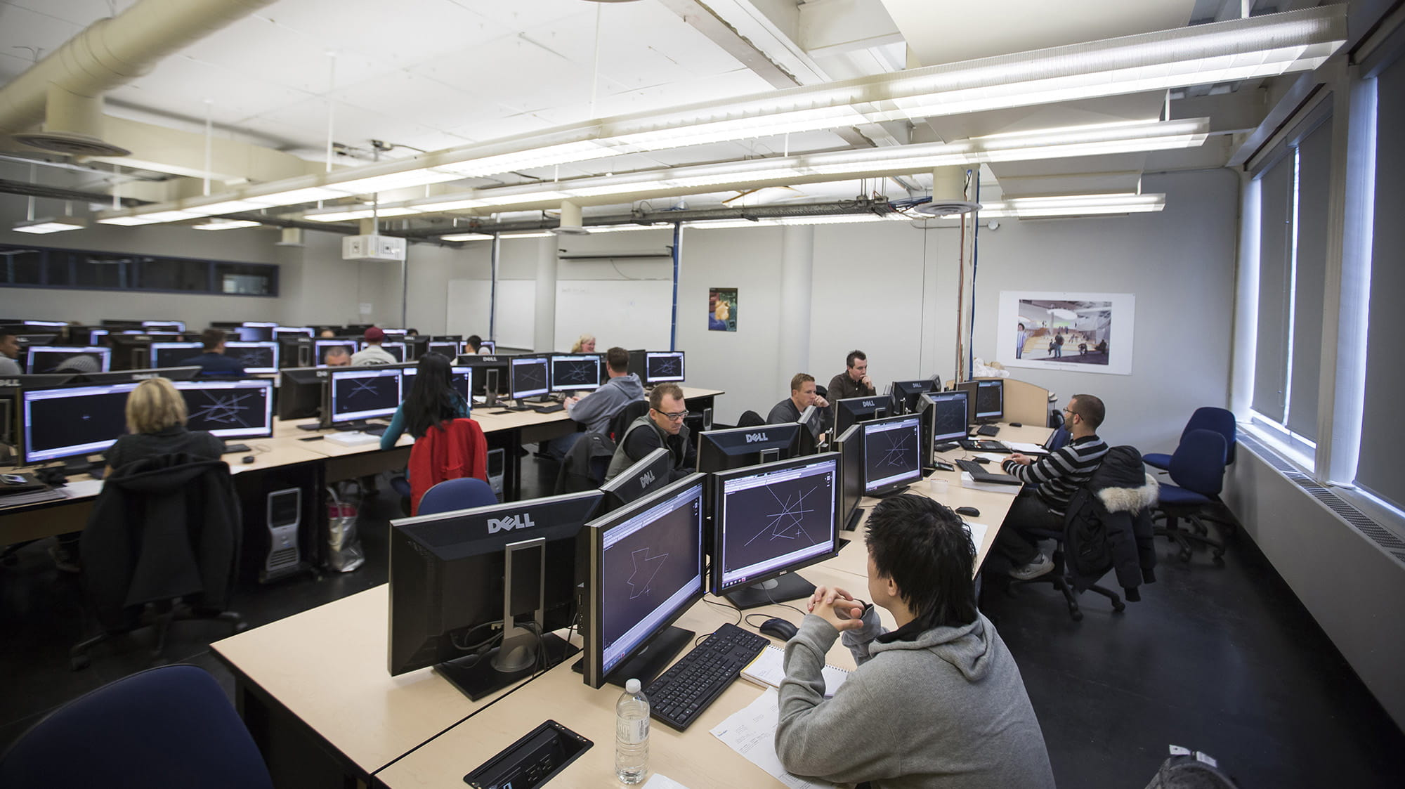 Students working at computers in a CAD lab