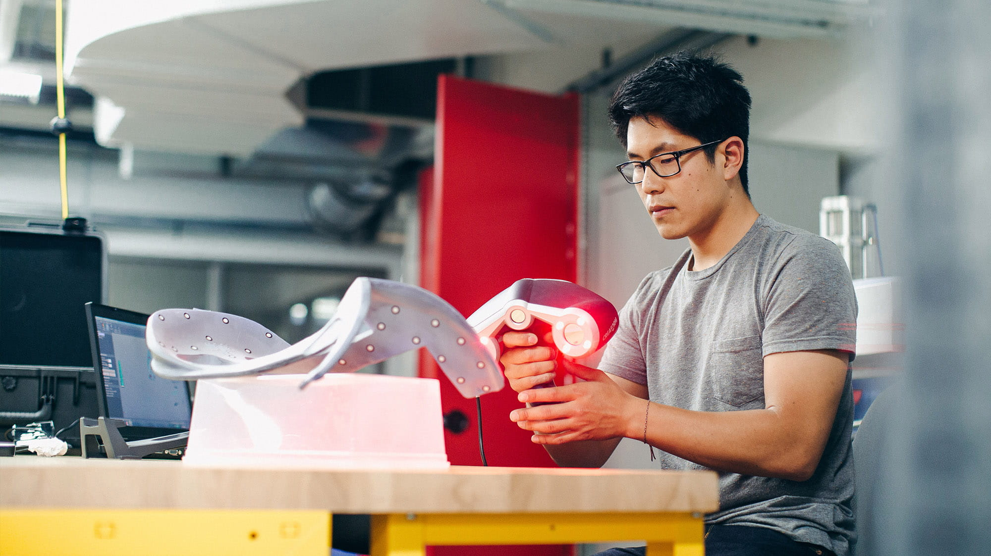 A Sheridan engineering student working with lab equipment