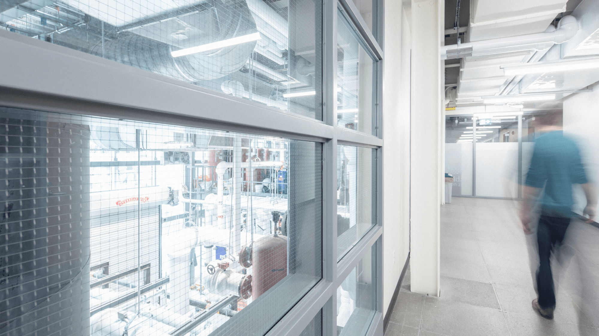A hallway at Sheridan's Skilled Trades Centre with windows overlooking a workshop below.
