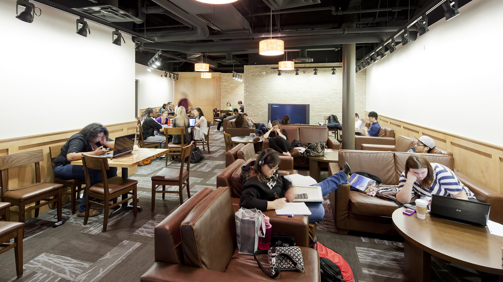 Students lounging and studying in the Bruin Coffee House at Sheridan's Davis Campus