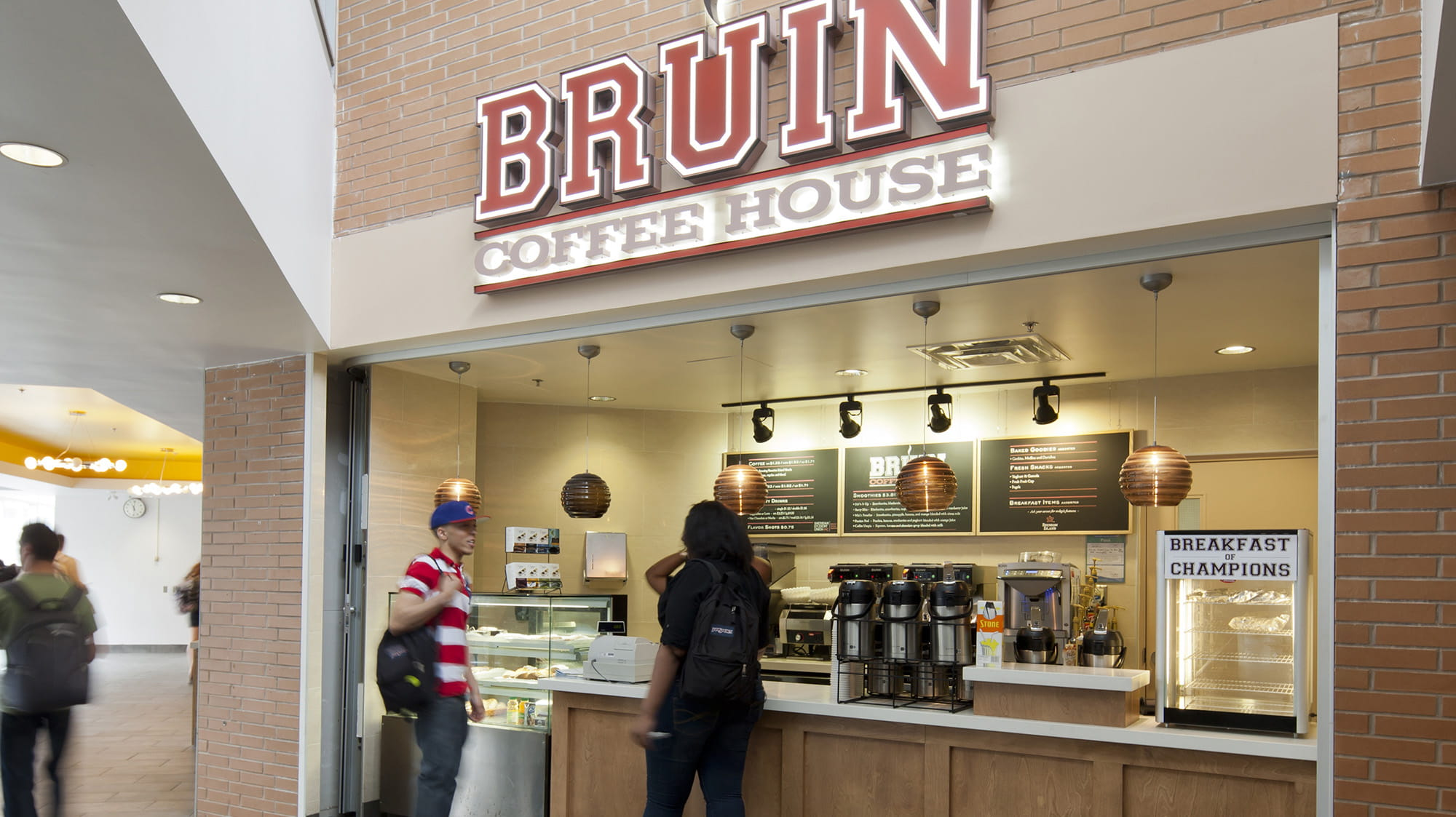 The Bruin Coffee House sign over the counter where students are ordering coffee