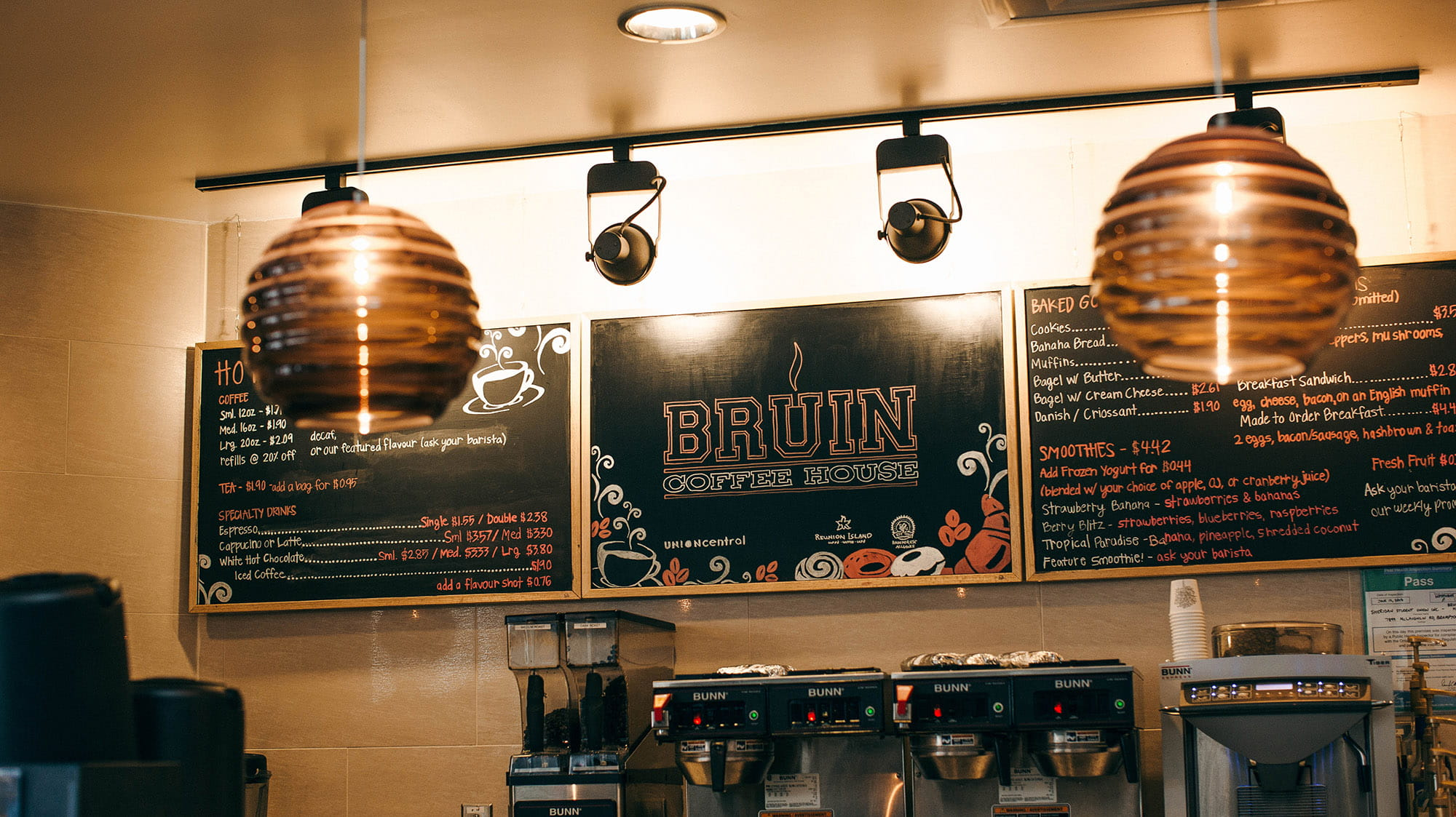 A wall with chalk boards showing the menu for the Bruin Coffee House at Sheridan