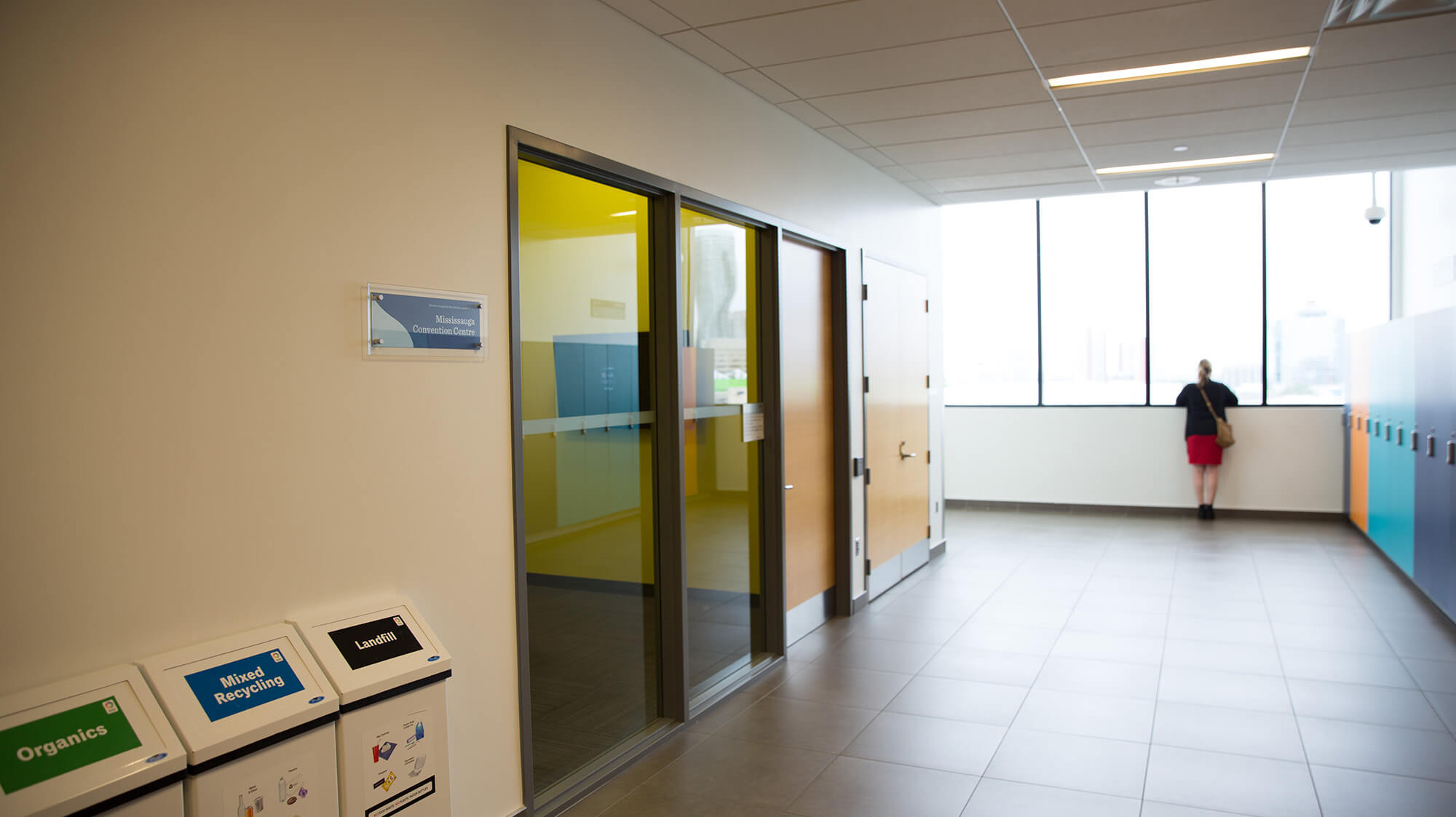 A bright hallway with sliding glass doors ouside a Group Study Room