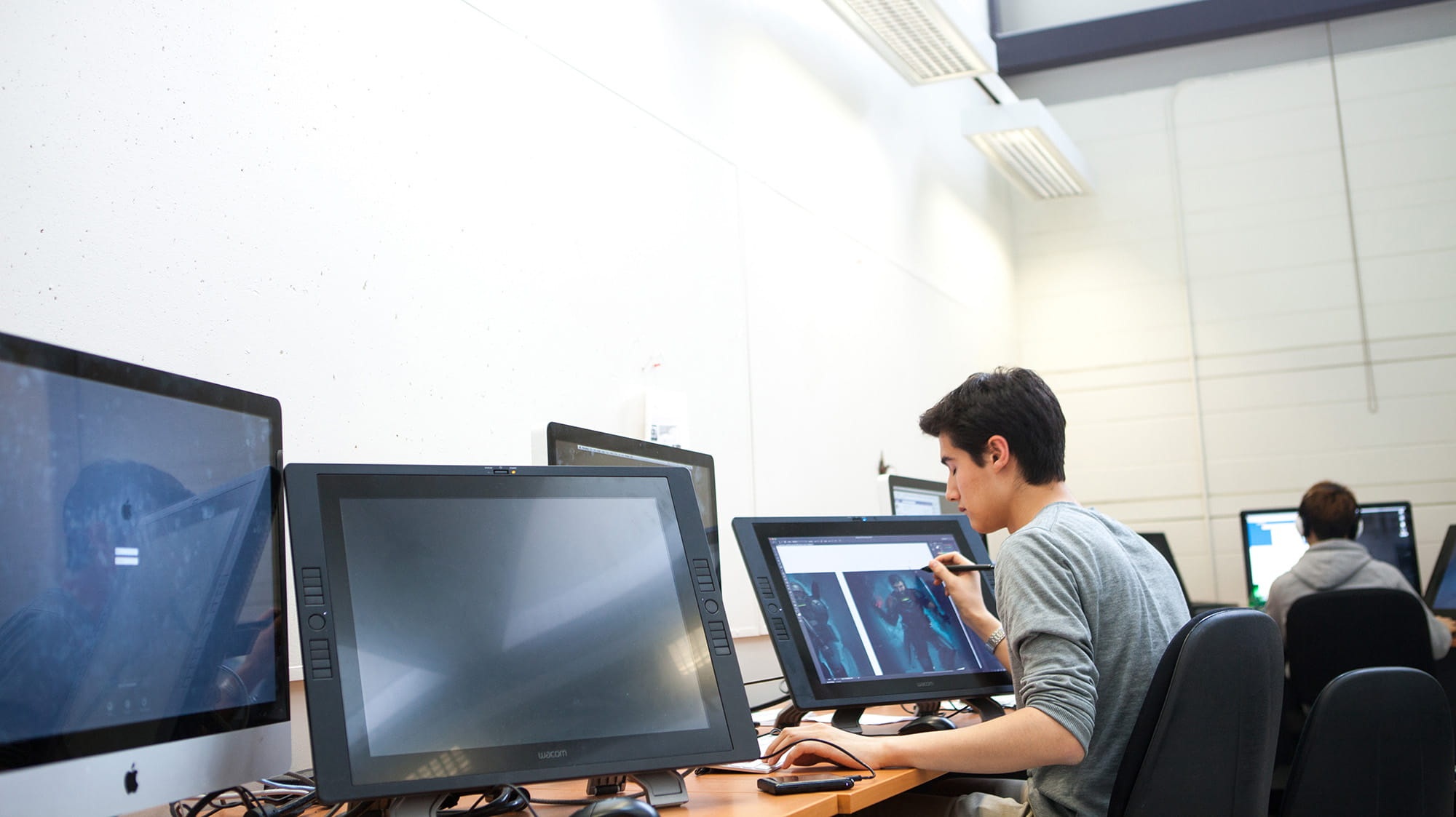A student working on a computer inside the Animation Lab