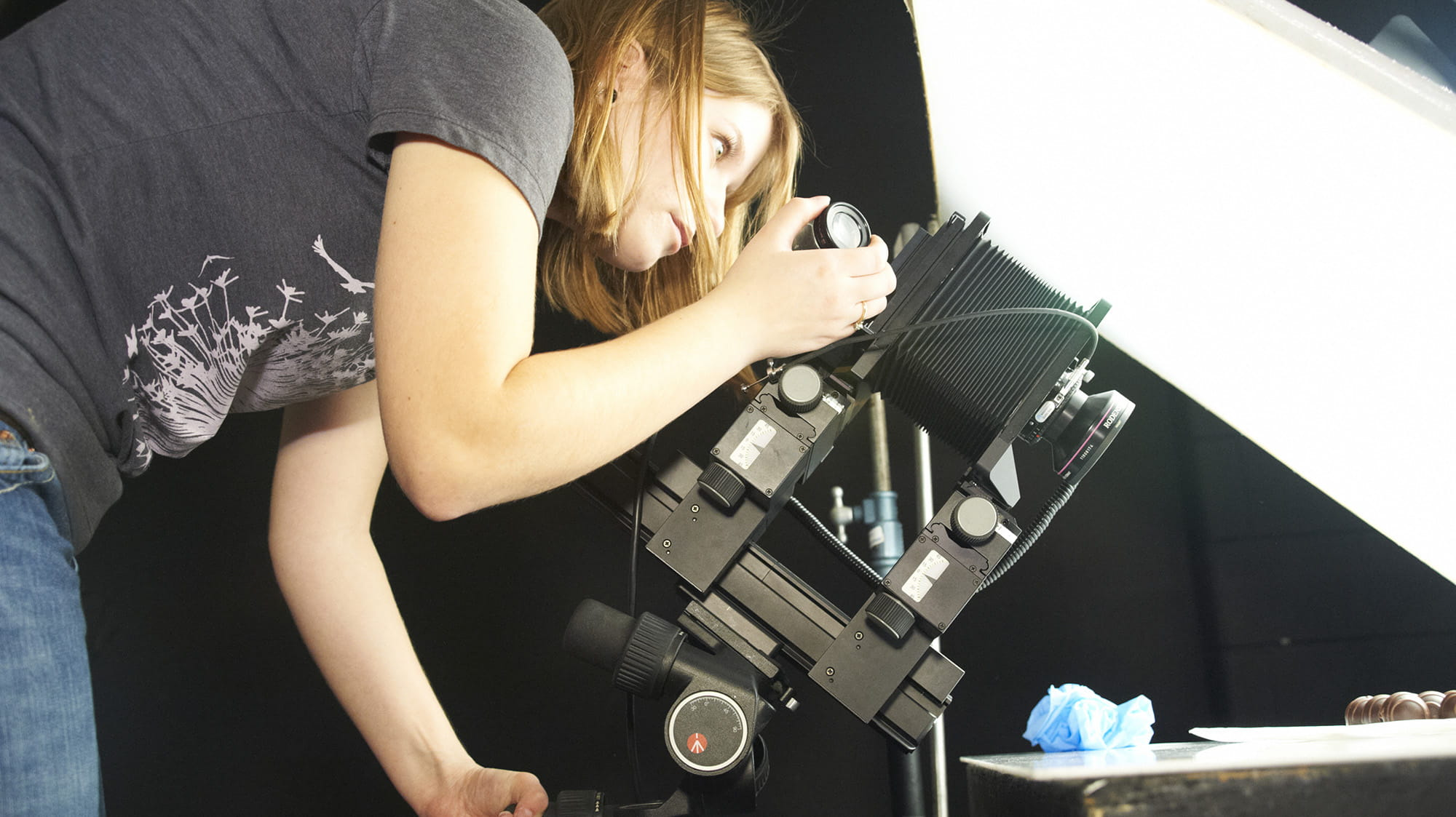 A student working with a large camera in the Photography Lab