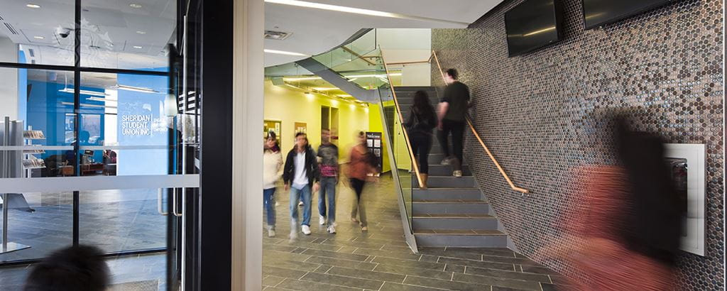 Students walking down the hall at Sheridan's Hazel McCallion Campus