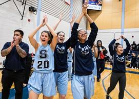 Sheridan Bruins Women's Basketball team celebrate
