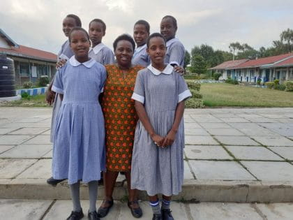Dr. Jane Ngobia (centre) in Kenya with students