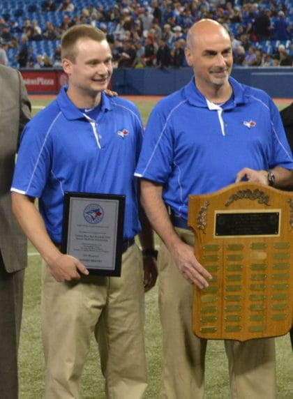 Tommy Kratky with George Poulis receiving an award from the Toronto Blue Jays