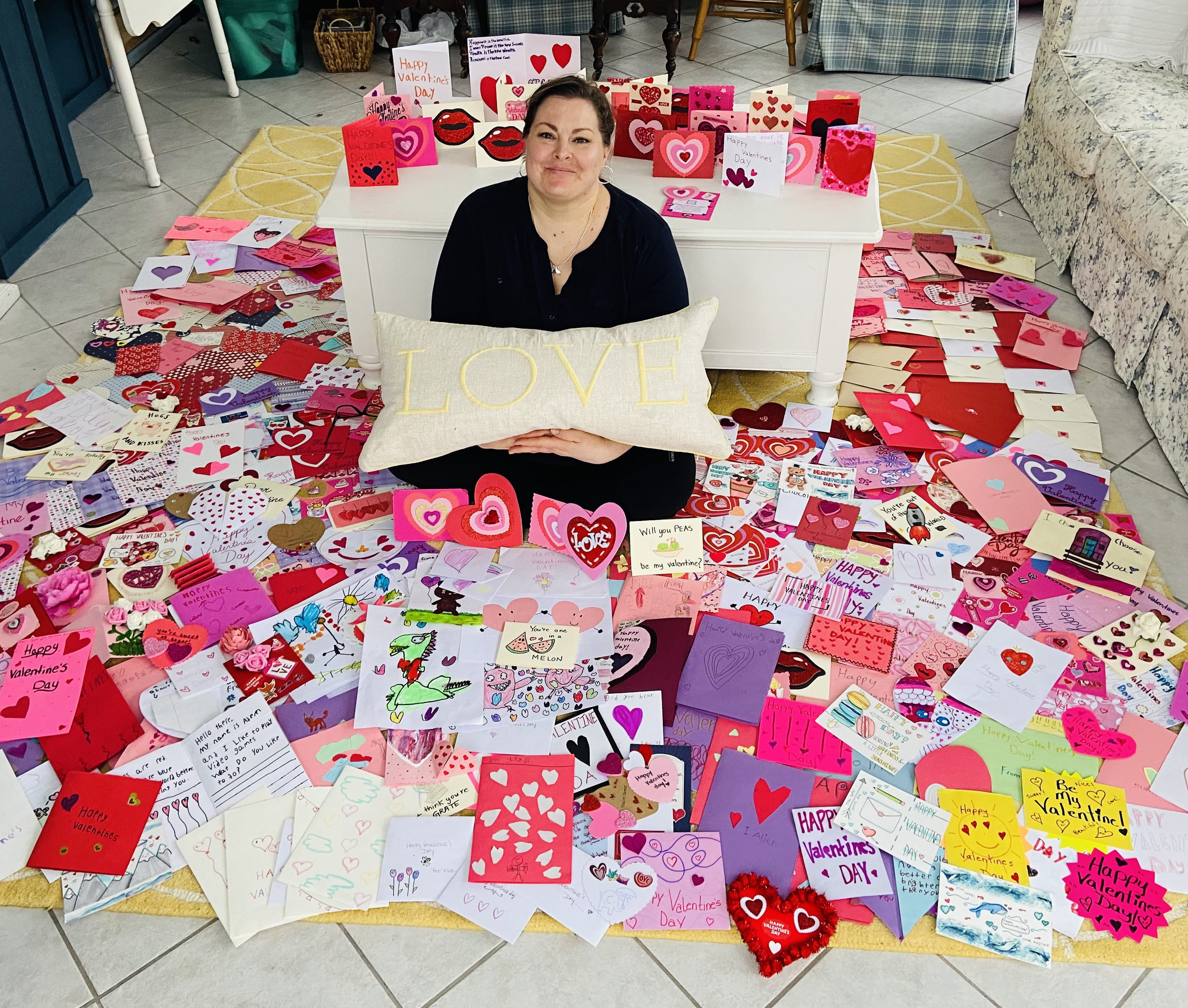 Amy Saccomano surrounded by hand-made Valentine's Day cards