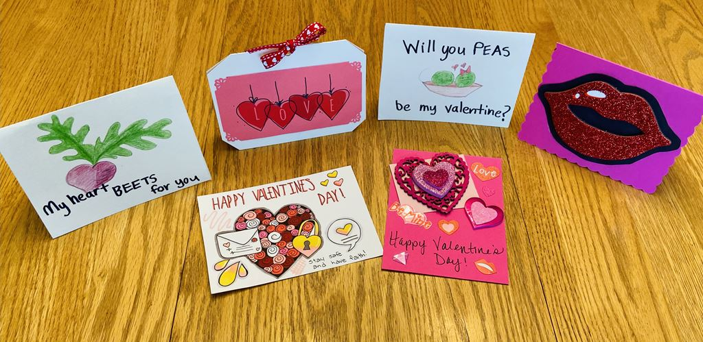 Hand-made Valentine's Day cards open on a table