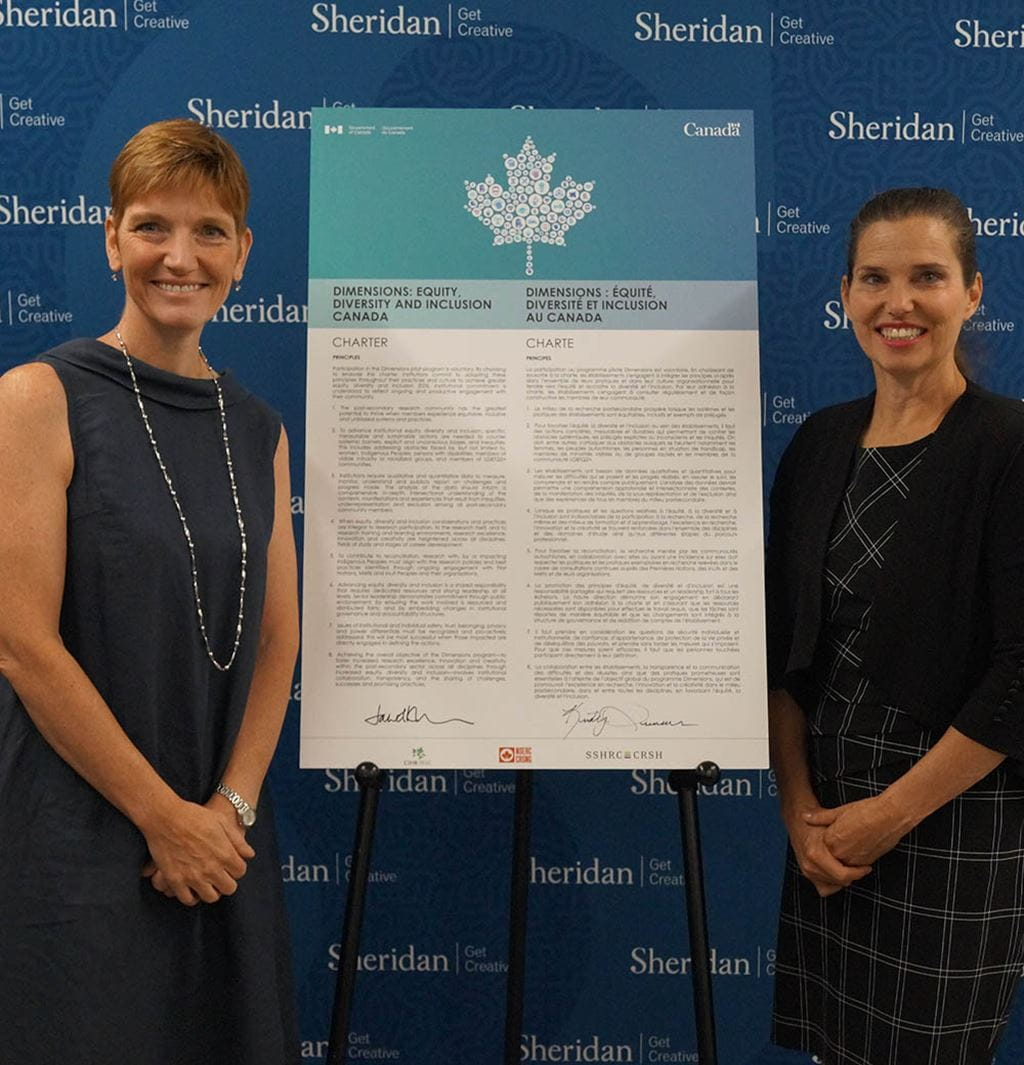 Janet Morrison and Minister Duncan with the Dimensions Charter
