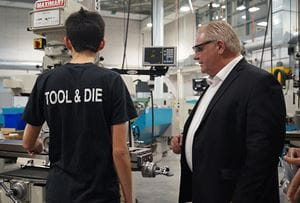 Tool and Die student speaking with Premier Doug Ford