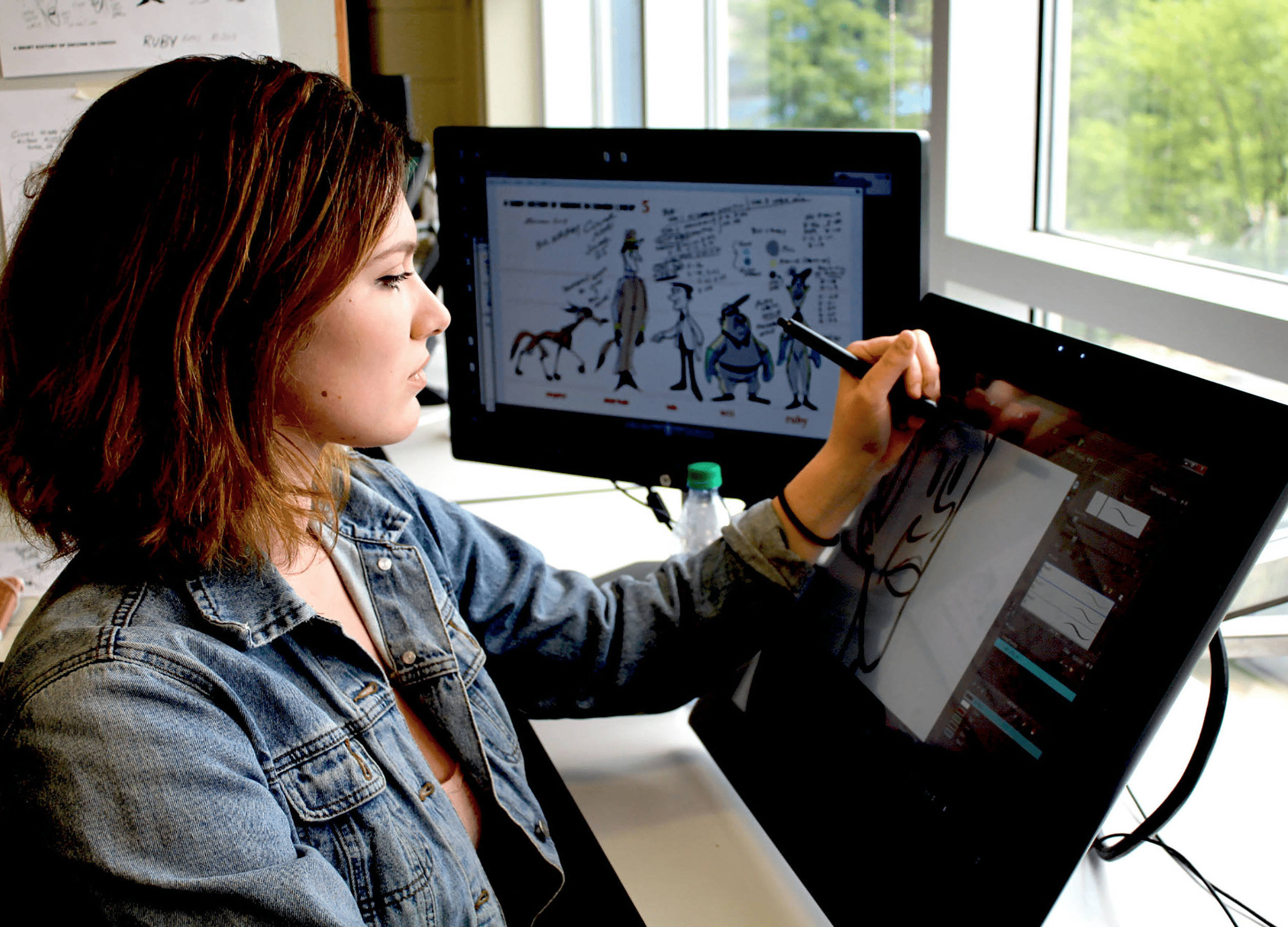 A student animating on a computer
