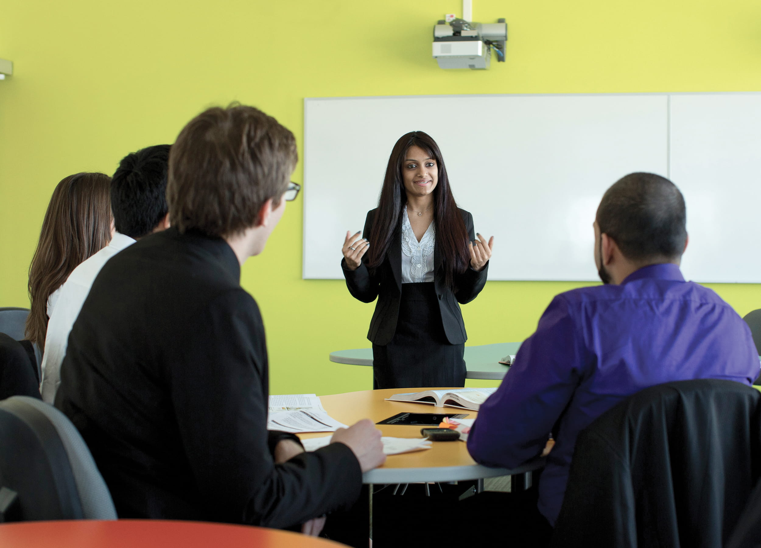 Business Administration instructor and students in a classroom