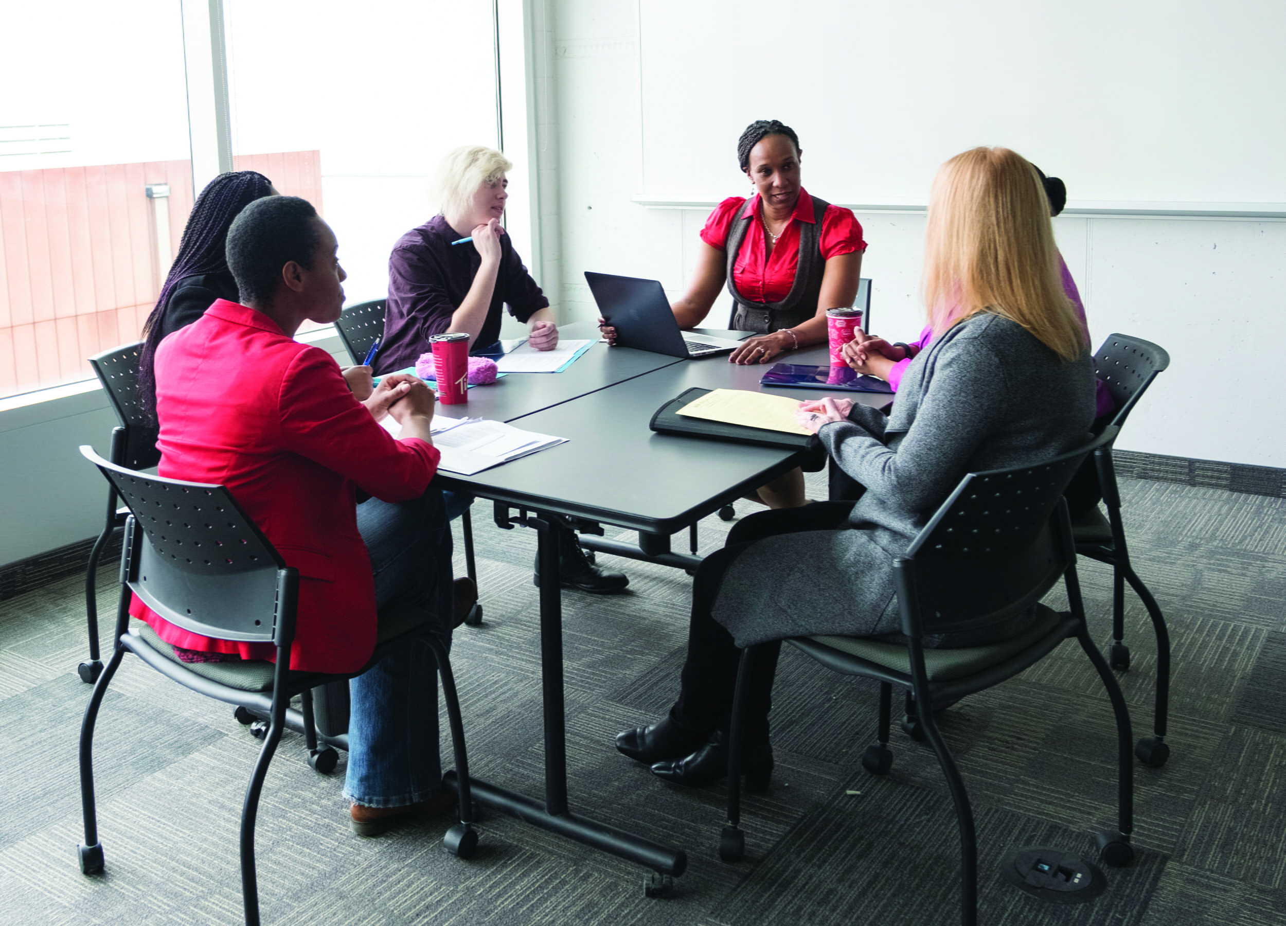 Social Service workers in a meeting room